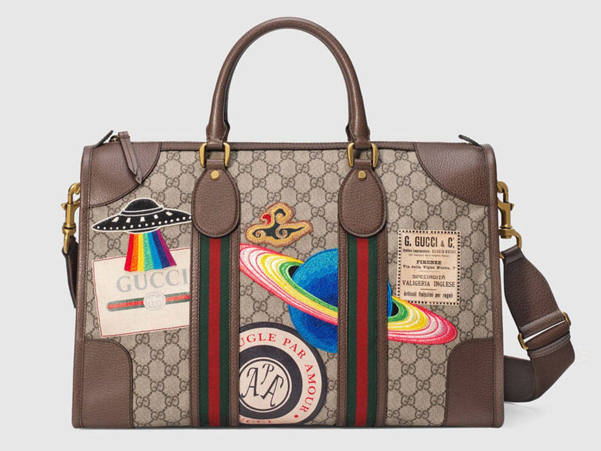 459311_K9RMT_8343_001_080_0000_Light-Gucci-Courrier-soft-GG-Supreme-duffle-bag.jpg