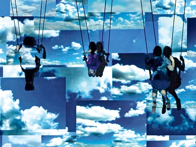 Performers swing into a video projection of a computer-enhanced blue sky in the artist's 2013 installation Swing Space
