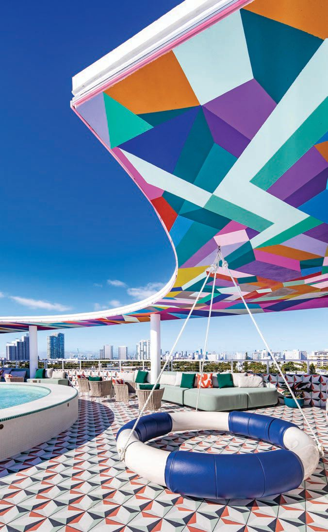 Playful lounge and poolside seating options on the eighth-floor rooftop. PHOTO BY MICHAEL KLEINBERG